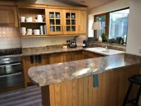 Complete kitchen with solid oak doors, hob, oven and sink - available from 29th October 2018