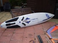 windsurfer board complete with sail etc