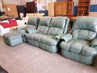 Green leather two seater recliner sofa with 2 matching armchairs and pouffe