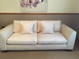 Two and three seater cream sofas in good condition