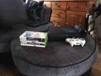 X Box 360. Excellent condition with controller and 5 games.