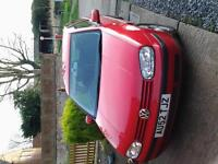 red vauxhall golf