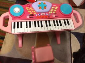 Pink Keyboard Piano toy with stool