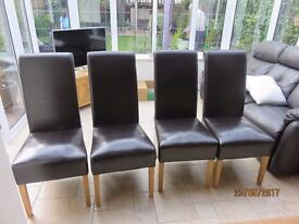 Set of 4 faux leather dining room chairs