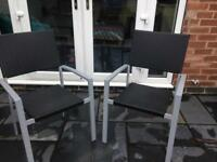 2 black rattan garden chairs