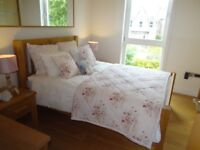Bedroom Suite, Oak double bed, two bedside cabinets, dressing table and stool. Excellent condition