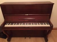 A used but in good condition Berry Piano