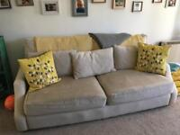 Large three seater sofa.