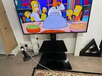 TV Stand with mount. Glass shelves.