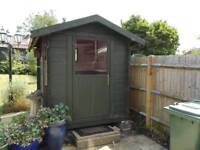 Green chalet shed