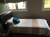 Dark Brown single leather bed.. good condition (mattress inc with bed if wanted.. hardly used)