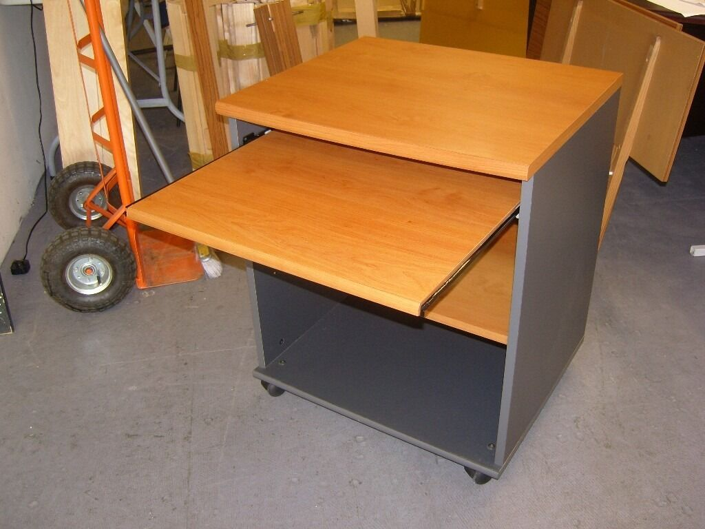 Computer Desk in Medium Wood Finish. Good Conditionin Sheffield, South YorkshireGumtree - Computer Desk in Medium Wood Finish. Good Condition Good quality compact computer desk. Medium wood effect on grey frame with sliding keyboard drawer. Middle shelf can be lowered or raised. On castors. Easy to dismantle if required for...