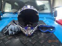 Motor bike helmet, gloves and goggles.