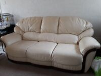 Three piece leather suite - includes one recliner chair.