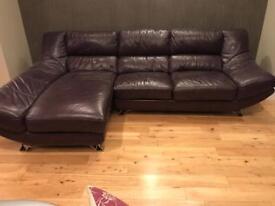 Four seater purple leather settee