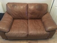 Used but good condition tan leather 2 seater sofa & matching storage foot stool