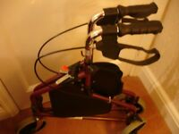 A 3 wheeler walking aid in superb condition with adjustable handle height and easy grip handles