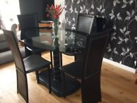 Modern Dining Table and Four Chairs.