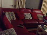 Large Italian red leather corner sofa and swivel chair