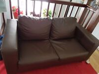 Leather sofa 2 seater for sale new condition