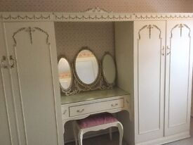 Jarman and Platt wardrobes and central drawer unit.