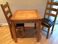solid oak small table and two chairs