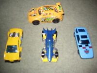 Four assorted toy cars