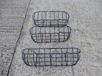 Three metal hay rack style wall planters