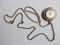 Oris ladies pendant watch with chain. Gold finish with decorated enamel rim.