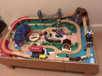 Children's wooden train set with table