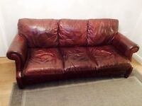 A Pair of Brown Leather Sofas