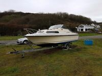 Clean Shetland 570 with mariner 60hp outboard and trailer
