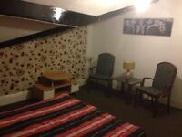 bed room is shared 2 bed flat, Couples OK, Stockport, furnished, close to transport, city centre.