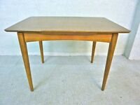 Vintage 1960's teak extending dining room table in original condition. Very cool and retro.