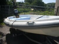 Walker Bay 310 RID with a Mariner 4HP Outboard Engine and Trailer