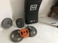 55kg weight plates + kickboxing pad. Pick up only
