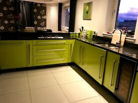 Lime green gloss fitted kitchen