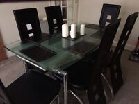 Glass dinning table and 6 chairs (can extend) good condition sale due to downsizing