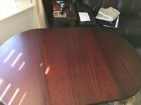 solid wood drop leaf dining table and 4 chairs including as new tablecloth