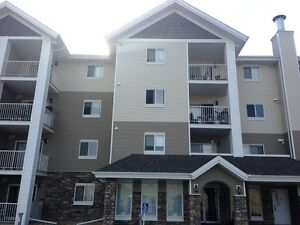 CRAZY VALUE!! 1 Bed + Den newer Condo in Sylvan Lake ONLY $925
