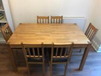 Solid oak table with 6 dining chairs