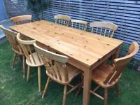 Lovely large pine table with 8 mixed styles chairs, 6ft long, good condition with drawer