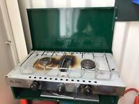 Camping stove with bottle