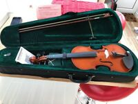Starter violin complete with accessories and carry case.