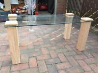 Glass coffee table with solid oak legs