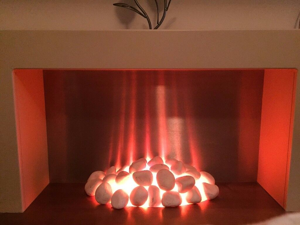 Electric Flicker Flame Fire with White Surround Fireplace. (originally bought from next)