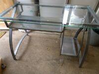 Glass topped desk, Silver frame, very sturdy. Has pull out keyboard shelf