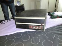 Record player antique playes both sizes of records small and lps its a bush