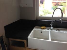 Granite Transformations worktop upstands and breakfast bar in Nero Corallo