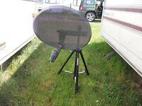 Satellite Dish on tripod, sky box and tv